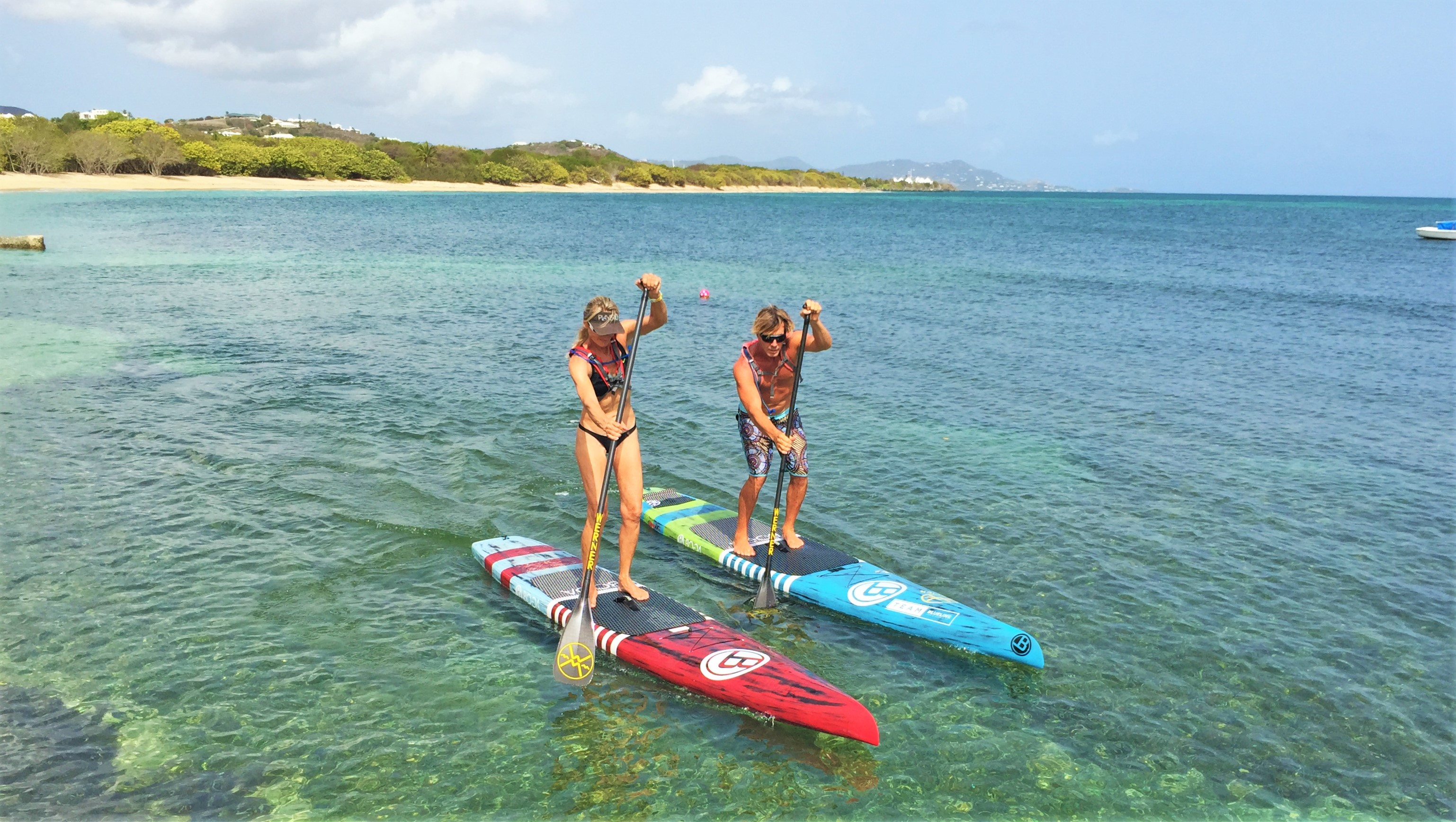 Paddle boarders at chenay bay beach resort st croix usvi