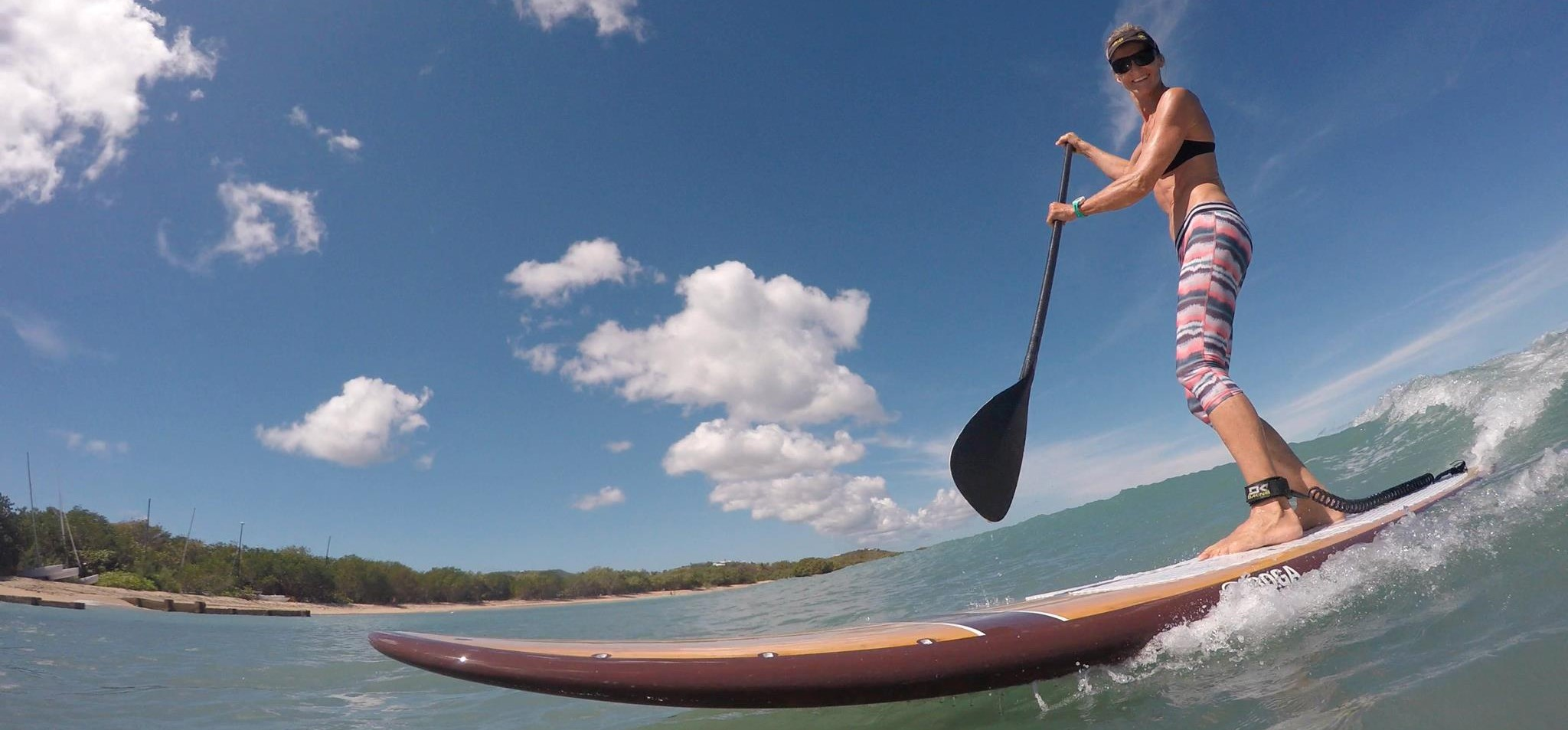 Paddleboarder riding a wave at kite st croix.