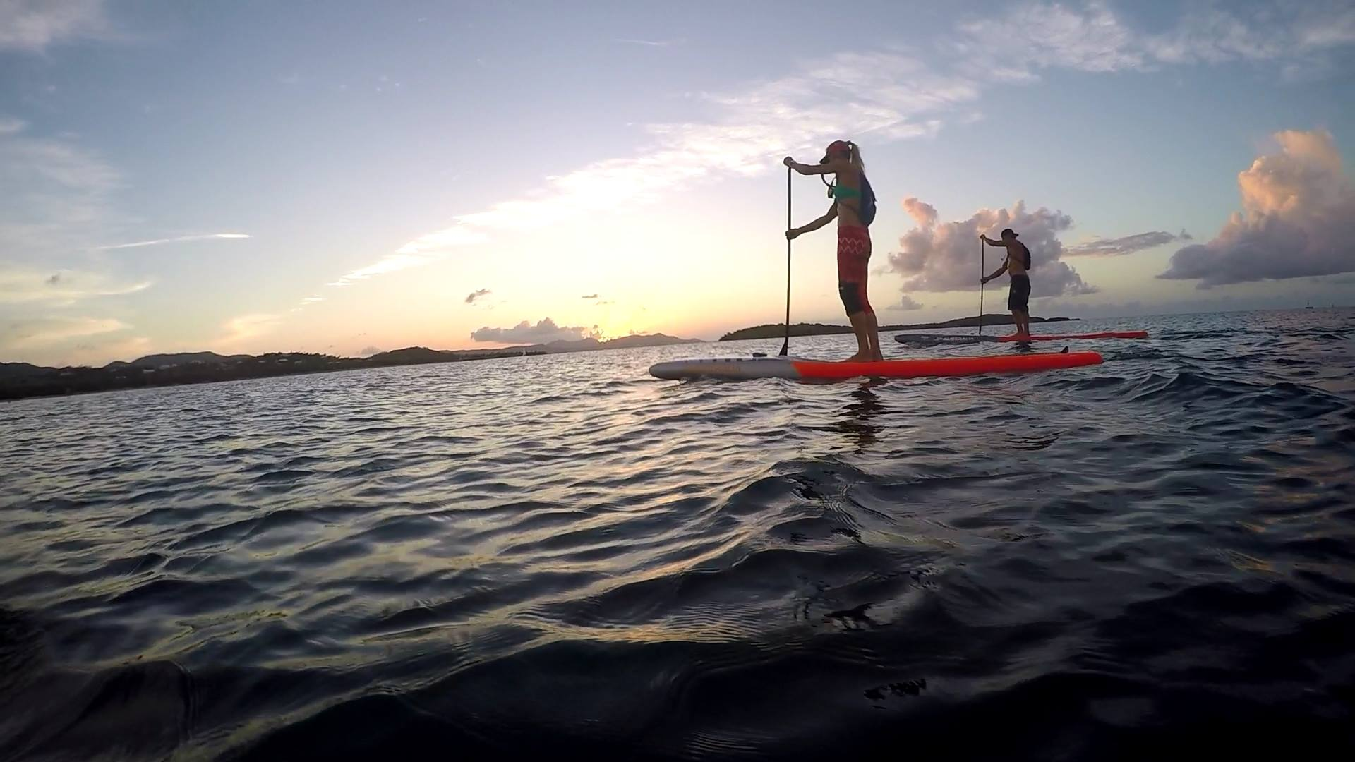paddleboarders enjoying a sunset at chenay bay beach resort on st. croix