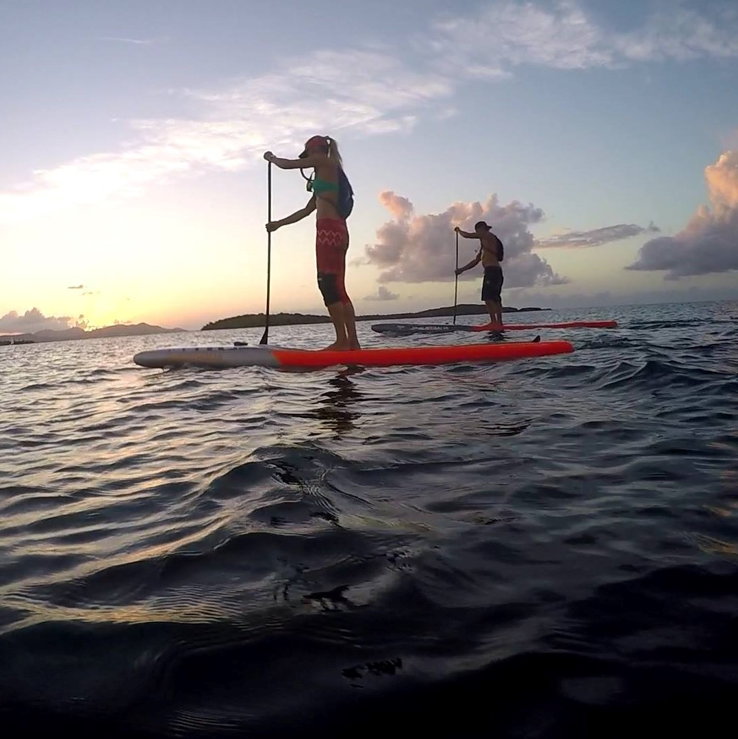 Bill Kraft and Isabel Picard paddleboarding at kite st croix